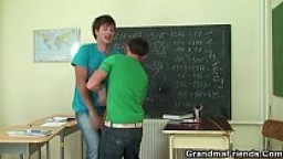 Very old teacher is pounded by two boys
